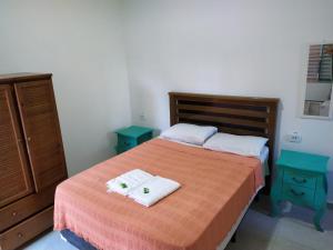 Cama ou camas em um quarto em Pousada Atlantic Sun