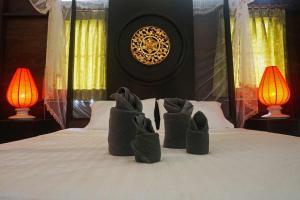 Ein Bett oder Betten in einem Zimmer der Unterkunft Baan Klong Kleng Koh Phayam