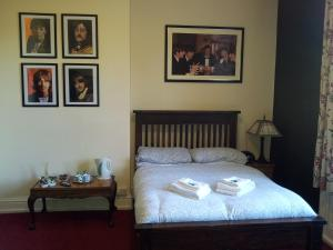 A bed or beds in a room at Stanley Park Hotel
