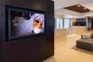 A television and/or entertainment center at Courtyard by Marriott Atlanta Executive Park/Emory