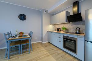 Kuchyň nebo kuchyňský kout v ubytování Apartament Praski Sen