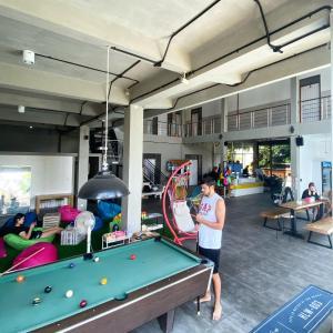 A billiards table at Beach Hut Hostel