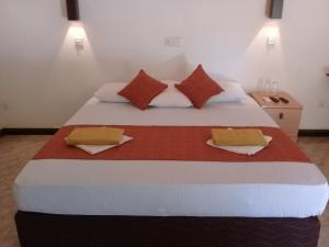 A bed or beds in a room at Kithmi Resort