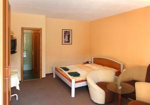 Postel nebo postele na pokoji v ubytování Penzion Jople