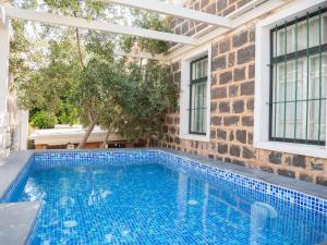 The swimming pool at or near Berenice Winery Villa