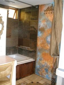 A bathroom at Secret Garden Inn