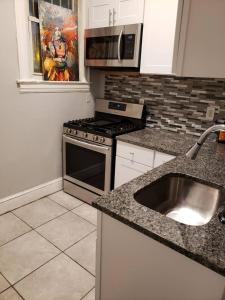 A kitchen or kitchenette at Indica Suites