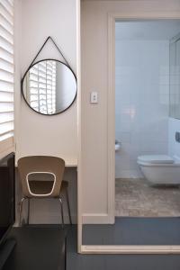 A bathroom at Ballantyne at Mosman - Serviced Apartments