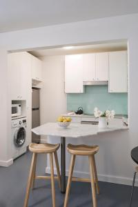 A kitchen or kitchenette at Ballantyne at Mosman - Serviced Apartments