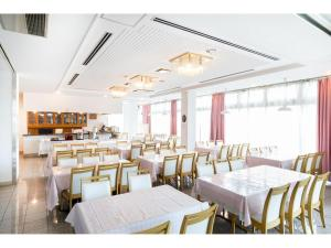 A restaurant or other place to eat at Hotel Yutaka Wing