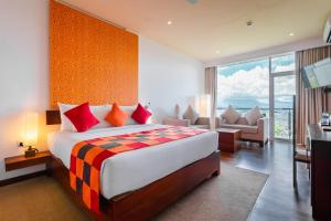 A bed or beds in a room at Mount Blue Kandy