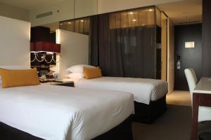 سرير أو أسرّة في غرفة في سنترو الشارقة - باي روتانا