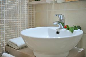 Ванная комната в Aristotelis Hotel