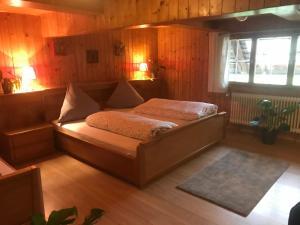 Ein Bett oder Betten in einem Zimmer der Unterkunft Stollenbacher Hütte