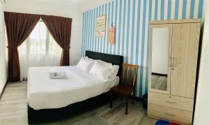 A bed or beds in a room at Likas Square by CozyCottage x Merveille @ Kota Kinabalu ,Sabah
