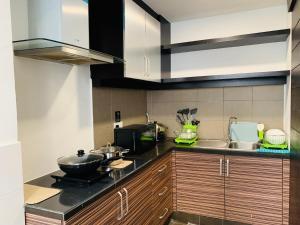 A kitchen or kitchenette at Likas Square by CozyCottage x Merveille @ Kota Kinabalu ,Sabah