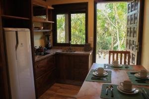 A kitchen or kitchenette at Caraguata Pousada
