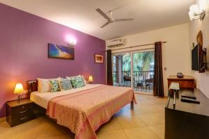A bed or beds in a room at Heritage Exotica Villa - 4BHK, Baga
