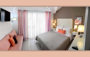 Ένα ή περισσότερα κρεβάτια σε δωμάτιο στο Haris Apartments