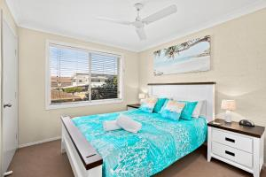 A bed or beds in a room at Blue Haze 3 - Sawtell, NSW