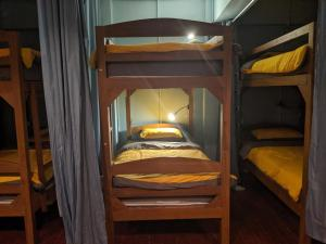 A bunk bed or bunk beds in a room at Nest Hostel Yangon