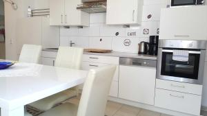 A kitchen or kitchenette at Holiday Apartment Essen