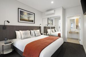 A bed or beds in a room at Quest Orange