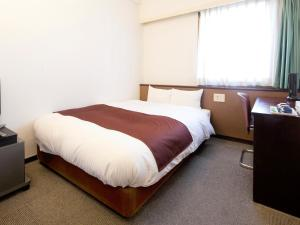 A bed or beds in a room at Hotel Abest Nagano Ekimae