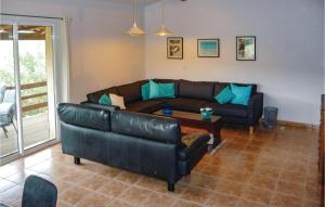 A seating area at Awesome home in Pierrerue w/ WiFi, 3 Bedrooms and Outdoor swimming pool
