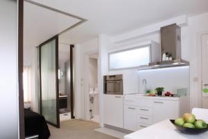 A kitchen or kitchenette at Miró Studio Apartments Dubrovnik