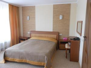 Кровать или кровати в номере Отель Первоуральск