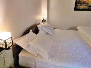 Ein Bett oder Betten in einem Zimmer der Unterkunft Cp Villa