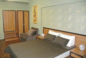Кровать или кровати в номере Бутик-Отель Сургут