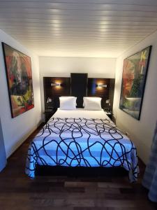 Ein Bett oder Betten in einem Zimmer der Unterkunft Brienzersee