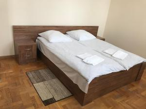 A bed or beds in a room at Motel Sofiivka
