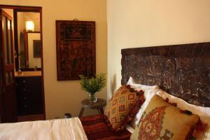 Ein Bett oder Betten in einem Zimmer der Unterkunft San Rafael Hotel