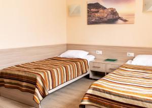 Кровать или кровати в номере Парк Отель Алмаз