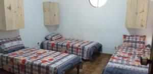 A bed or beds in a room at Pousada Lucena