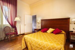 Letto o letti in una camera di Hotel Alessandro Della Spina