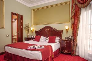 Ліжко або ліжка в номері Staro Hotel