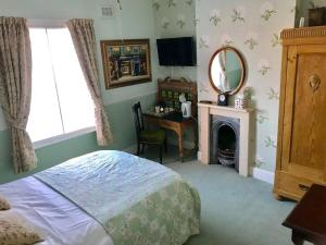 A bed or beds in a room at Durham Ox Ilkeston