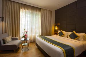 A bed or beds in a room at Fountain Tree by TGI
