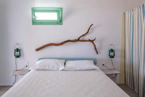 A bed or beds in a room at Ailouros guest house