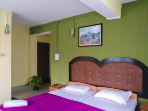 A bed or beds in a room at Ashraya - Boutique Homestay