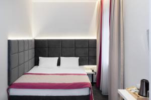 Кровать или кровати в номере Минима Белорусская