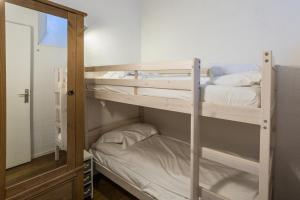 A bunk bed or bunk beds in a room at Apartment Jonquille 3
