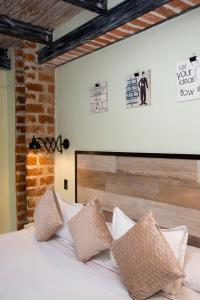 Un ou plusieurs lits dans un hébergement de l'établissement Maloka Boutique Hostel
