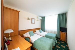 A bed or beds in a room at Kolomna Hotel