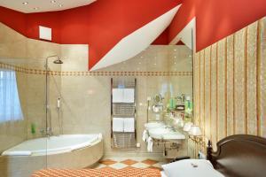 A bathroom at Austria Trend Hotel Ananas Wien