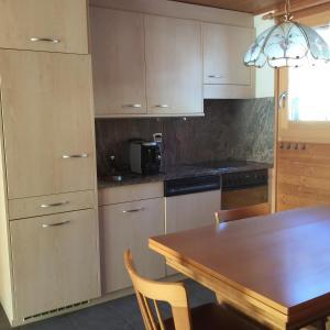 Küche/Küchenzeile in der Unterkunft Chalet Foresta OG